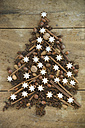 Christmas tree shaped of cinnamon stars nuts, almonds, cinnamon sticks and star anise - ASF005560