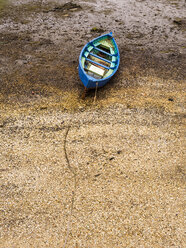 Chile, Puerto Montt, rowing boat lying on sand - STSF000722