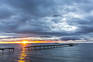 Chile, Punta Arenas, broken old jetty at sunrise - STSF000725