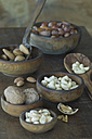 Wooden bowls of different nuts - ASF005573