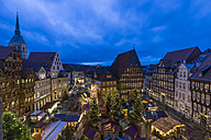 Germany, Lower Saxony, Hildesheim, Christmas market in the evening - PVCF000406