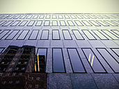 Germany, Duesseldorf, facade of modern office building with reflection of another building - HOHF001325
