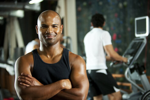 Portrait of smiling man in a gym - SELF000051