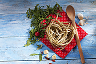 Uncooked Tagliatelle with rocket, parmesan, chili pods, rocket salad and wooden spoon - CSF025304