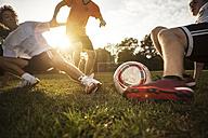 Sliding tackle on soccer pitch - GCF000066
