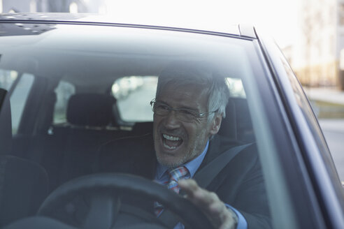 Angry businessman in his car - RBF002652