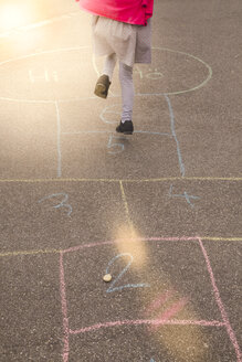 Little girl playing hopscotch - SARF001739