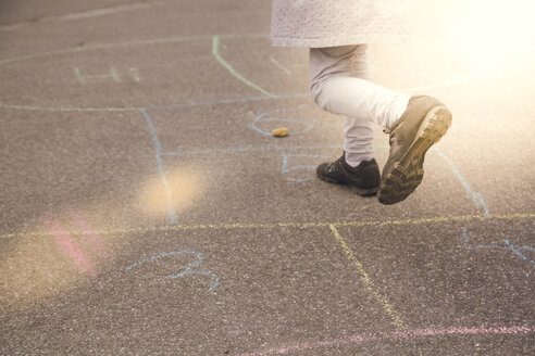 Little girl playing hopscotch - SARF001740