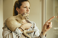 Woman with Burmese cat at the window - MFF001563