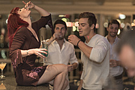 People drinking schnaps in a bar - ZEF005328