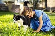 Little girl with cat on a meadow - LVF003198