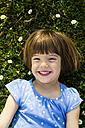 Portrait of happy little girl lying on a meadow - LVF003197