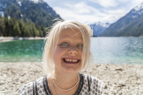 Austria, Tyrol, Lake Plansee, portrait of happy girl - TCF004626