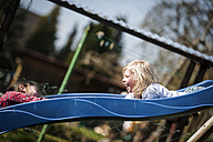 Two happy girls on a slide - PAF001300