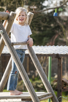 Happy girl on playground - PAF001304