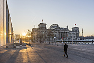 Germany, Berlin, Berlin-Tiergarten, Reichstag building against the sun in the morning - PVC000415