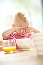 Tired baby at beakfast table - MFRF000221