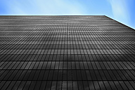 Germany, Hamburg, glass facade of an office building in black - RJF000429