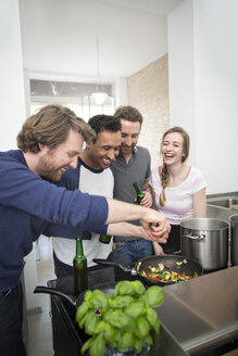 Happy friends cooking together - FKF000952