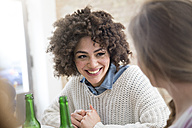 Happy female friends with beer bottles - FKF000963