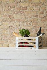 Wooden box with vegetables, pasta, baguette, basil and wine bottle - FKF001033