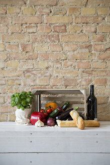 Wooden box with vegetables, baguette, basil and wine bottle - FKF001036