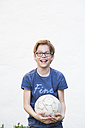 Portrait of laughing boy with soccer ball - LVF003261