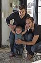 Happy gay couple with kid - ZEF004437