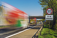 Germany, Grevenbroich, trucks on motorway, sign speed limit, noise protection - FRF000249