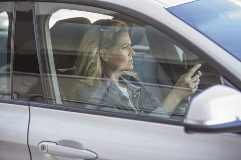 Woman in car - ZEF004903