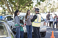 People and policeman at car accident scene - ZEF004758