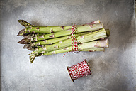 Bunch of green asparagus on metal plate - EVGF001674
