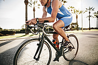 Spain, Mallorca, Sa Coma, triathlet training on bicycle - MFF001602