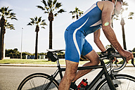 Spain, Mallorca, Sa Coma, triathlet training on bicycle - MFF001604