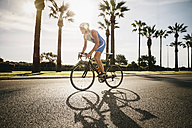 Spain, Mallorca, Sa Coma, triathlet training on bicycle - MFF001605