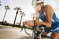Spain, Mallorca, Sa Coma, triathlet training on bicycle - MFF001609
