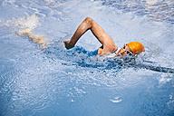 Spain, Mallorca, Sa Coma, triathlet  swimming in a pool - MFF001611