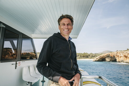 Spain, Mallorca, portrait of smiling man standing on a boat - MFF001599