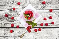 Raspberries, chia, milk, kiwi, hemp seed and mint in a glass - LVF003315