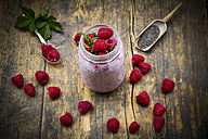Raspberries, chia, milk, kiwi, hemp seed and mint in a glass - LVF003319