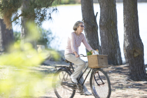 Senior woman riding on bicycle - ZEF004741