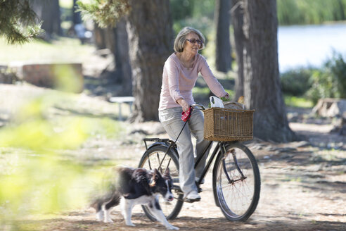 Senior woman riding on bicycle - ZEF004742