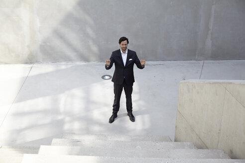 Businessman in a modern building - FMKF001531