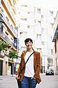 Spain, Barcelona, smiling businesswoman walking on a street - EBSF000605
