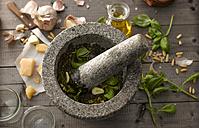 Preparing basil pesto with mortar - KSWF001471