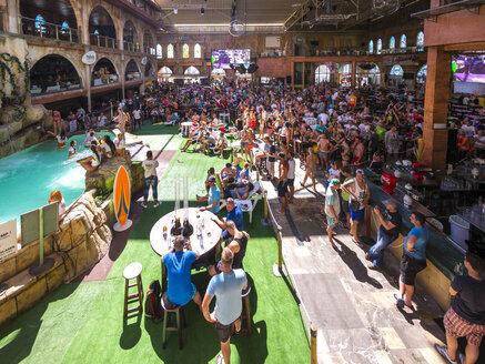 Spain, Majorca, Playa de Palma, El Arenal, crowd of people at Megapark pub - AM003991
