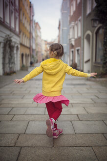 Germany, Bavaria, little girl dancing in an alley - OPF000054