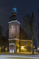 Germany, Hamburg, illuminated church at Christmas time by night - NKF000239