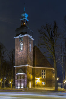 Germany, Hamburg, illuminated church at Christmas time by night - NKF000239