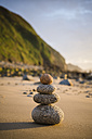 Spain, Galicia, Valdovino, Four small rocks in balance on the beach - RAEF000170